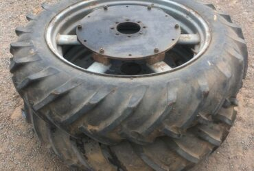Pair of tractor tyres and rims with Massey Ferguson 65 stud pattern